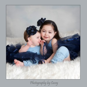 Photographer of sisters wearing tutus