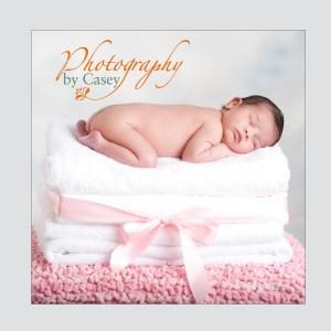 newborn baby sleeping on towels photographer