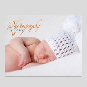 newborn in knit mouse ear cap photograph
