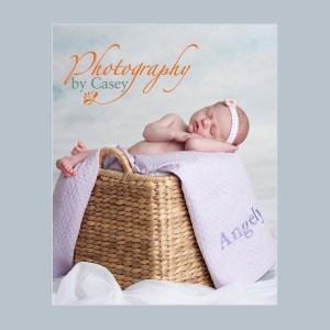 Infant sleeping in basket