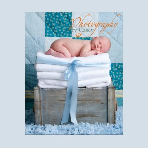 newborn sleeping baby with quilt background photograph