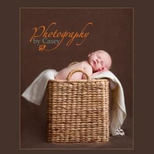 newborn sleeping baby in basket photographer