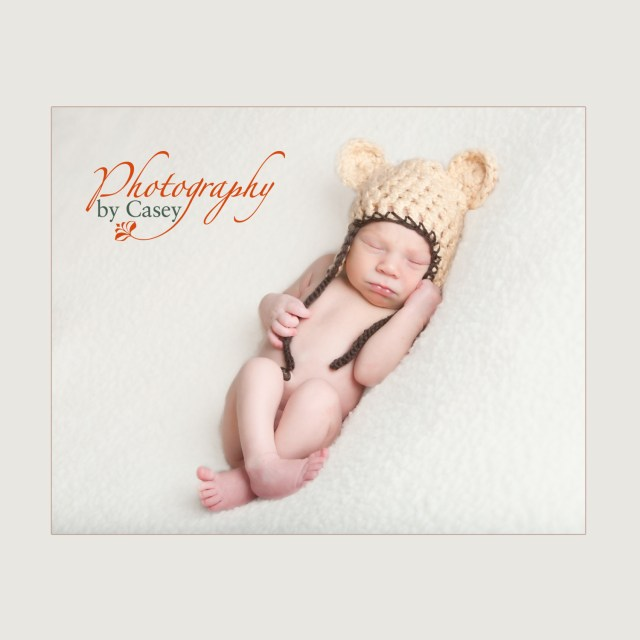 newborn baby inmonkey cap photography