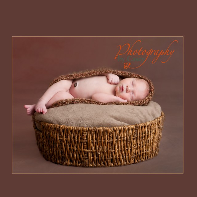 newborn baby sleeping in cocoon photography