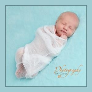 Newborn baby swaddled in muslin