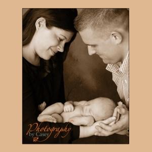 Sleeping Newborn with Mom & Dad