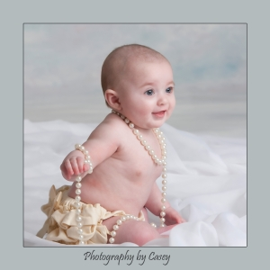 Photographer of Babies wearing Pearl Necklace