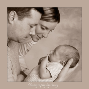 Photography of parent's holding sleeping baby
