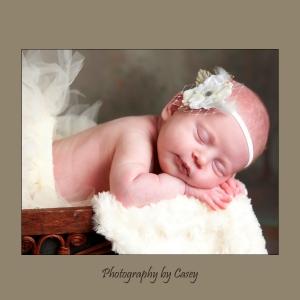 Sleeping newborn baby photographr