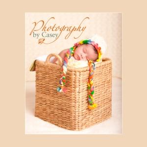 Newborb sleeping baby in basket photographer