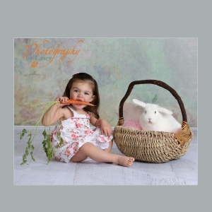 photography of baby girl with bunny