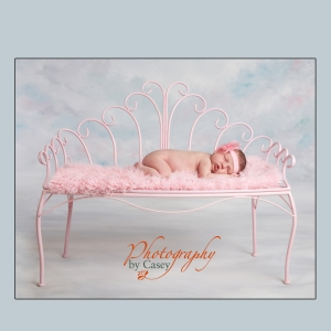 Sleeping Newborn on pink bench