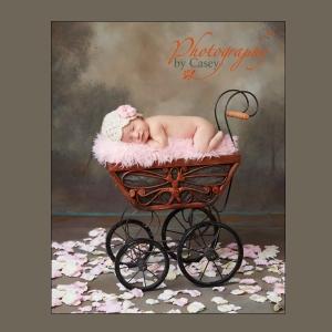 Sleeping Newborn Baby In Antique Carriage