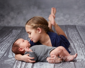 Sibling with newborn baby photography