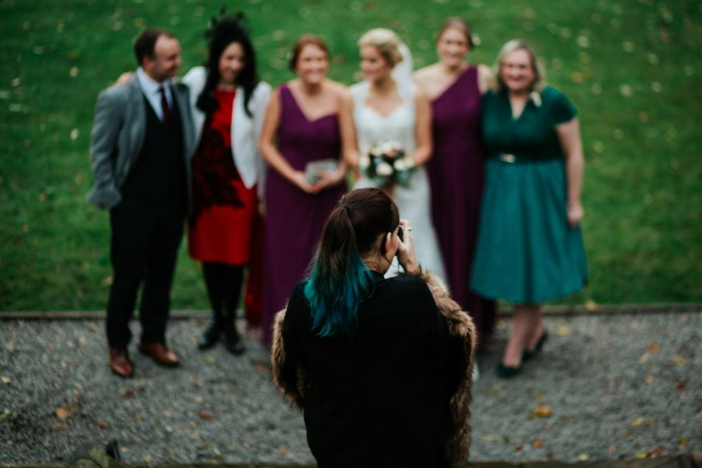 photographer takes pictures of bridal party