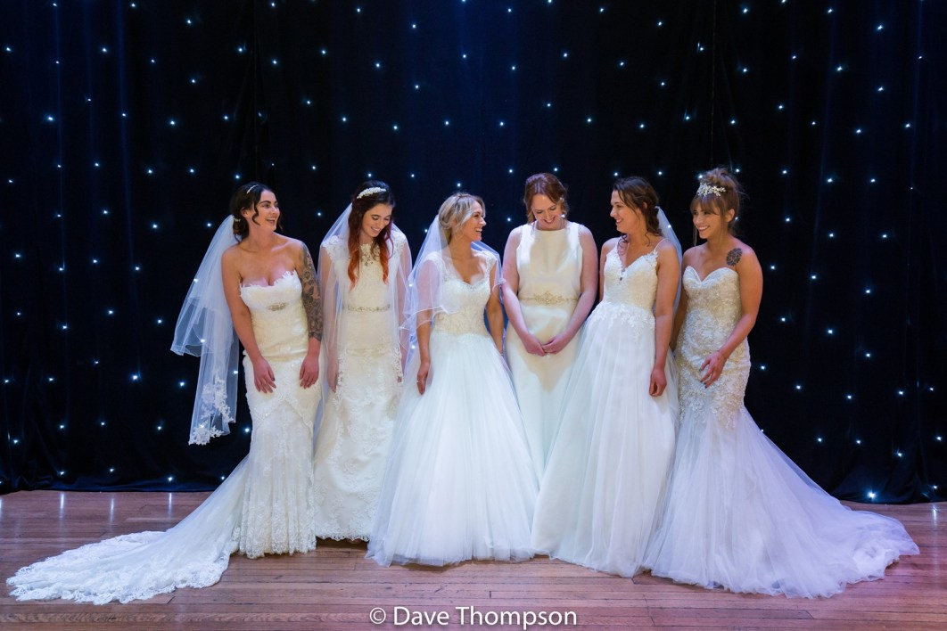 Brides on stage in wedding dresses at Stockport Town Hall Wedding Fayre organised by Stockport Events