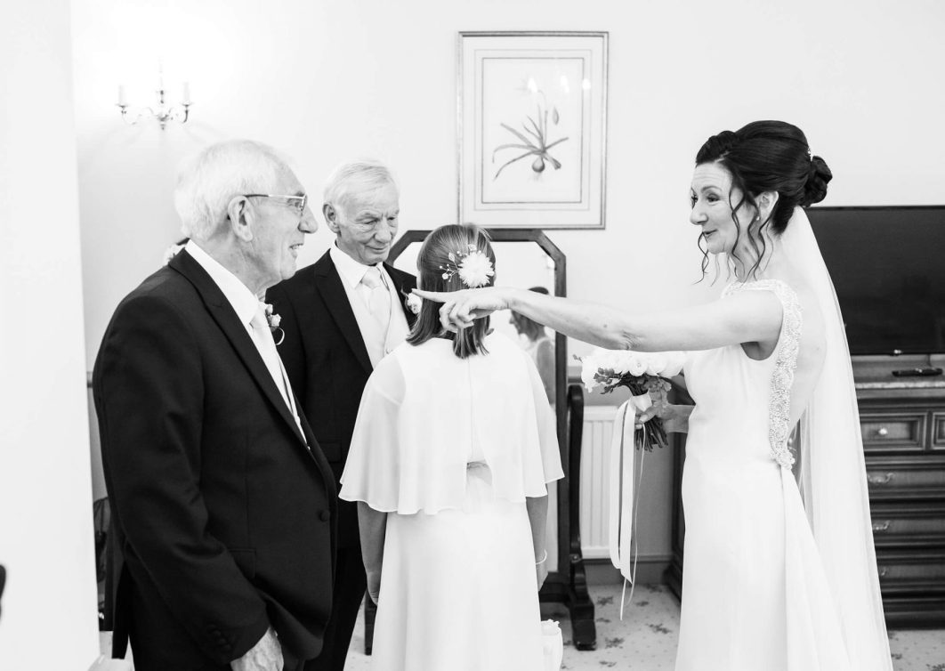 The bride talks to her father and step father before the wedding ceremony