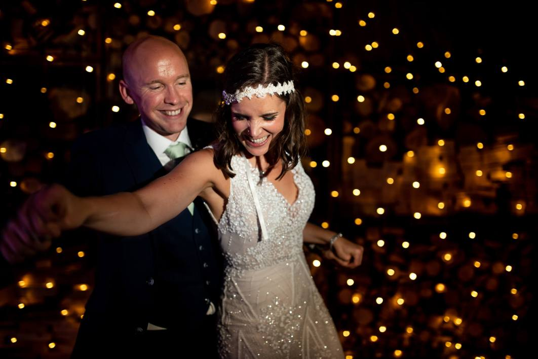 A bride and groom dance at The Comb wedding venue in Northumberland