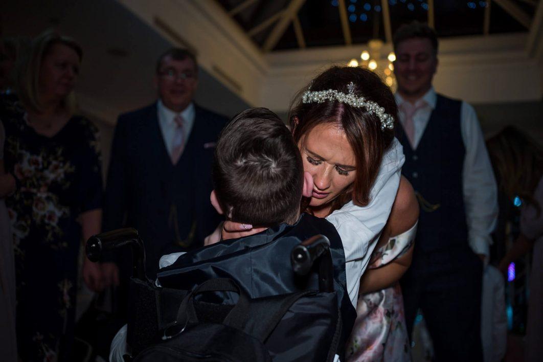 Hollin Hall Hotel Wedding Photographer - The bride hugs her son