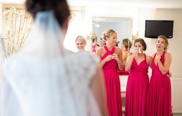 Bridesmades cry as they see the bride