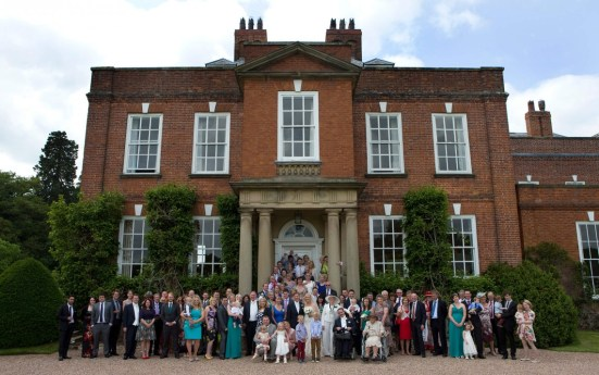 Large group shot outside the main building