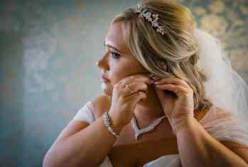 Bride puts her earrings in