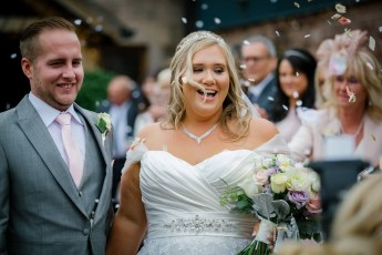 Bride and Groom with confetti