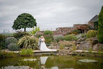 Bride and groom in the gardens at Heaton House Farm