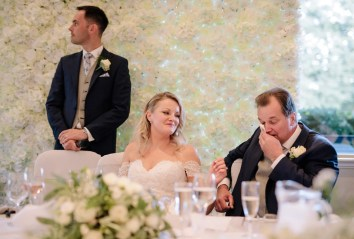 The father of the bride wipes a tear