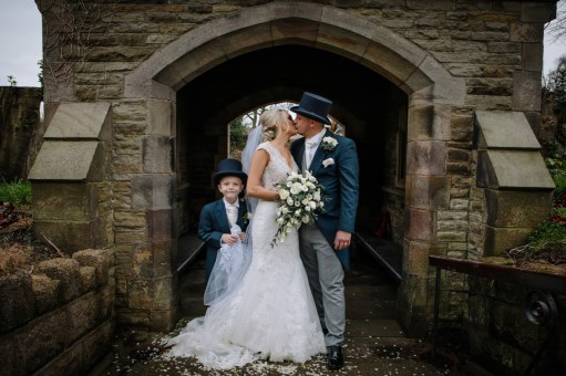 Bride and groom with the page boy