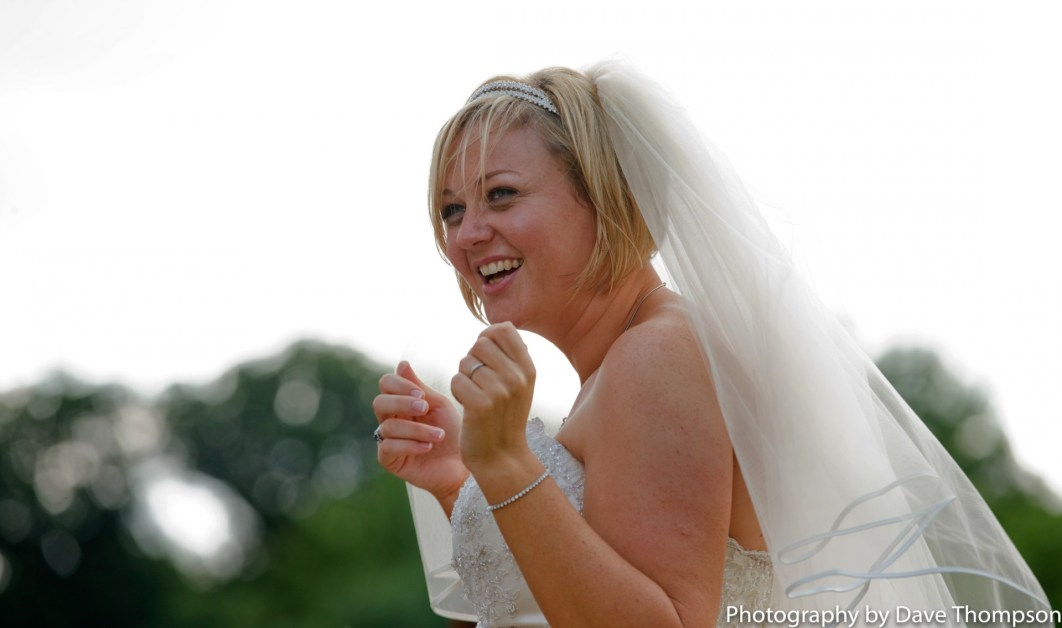 The bride laughs after her wedding