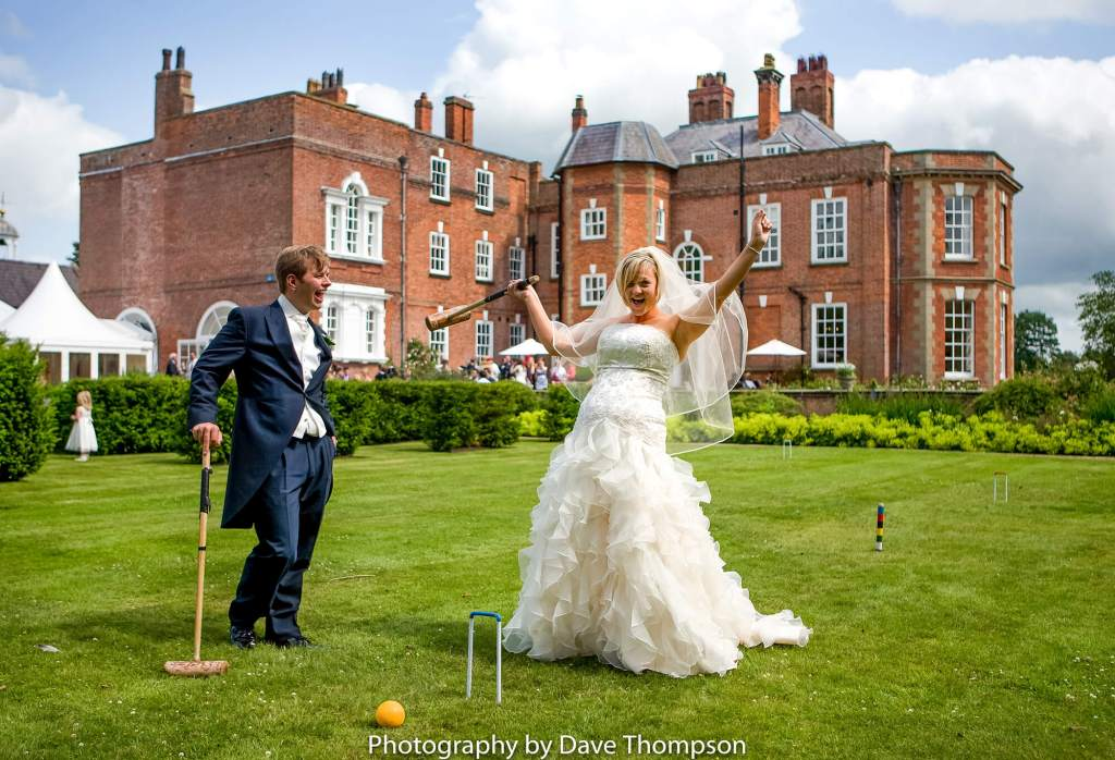 The newly married couple play croquet on the lawn at Iscoyd Park