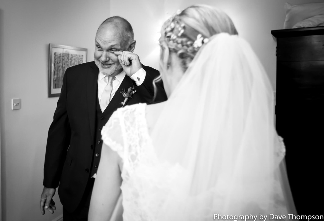 Dad wipes a tear as he sees his daughter