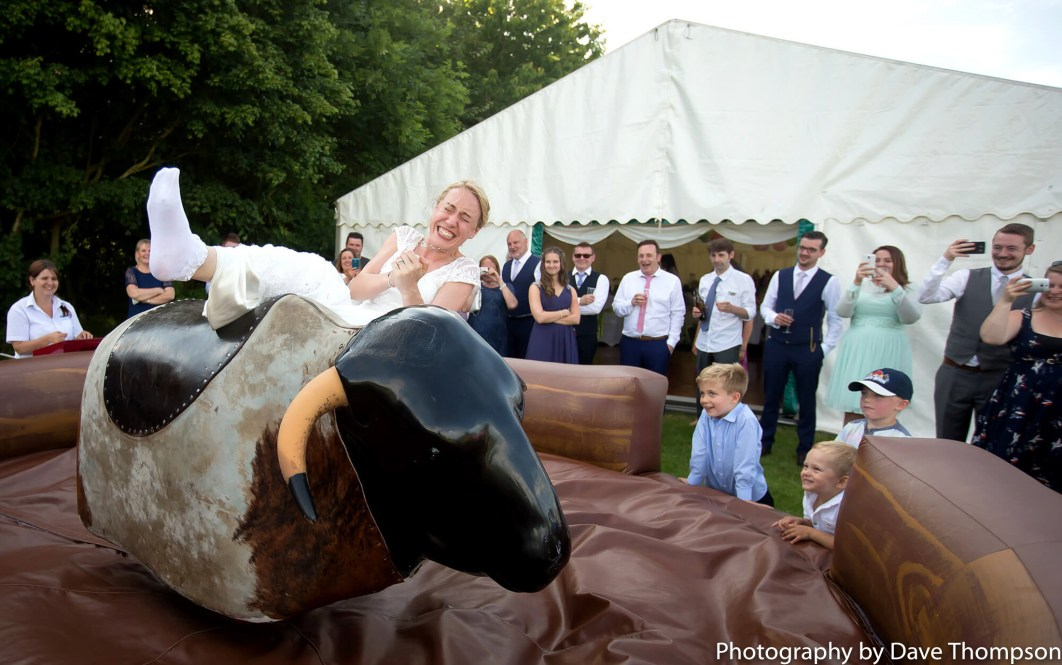 Bride falls off a rodeo bull