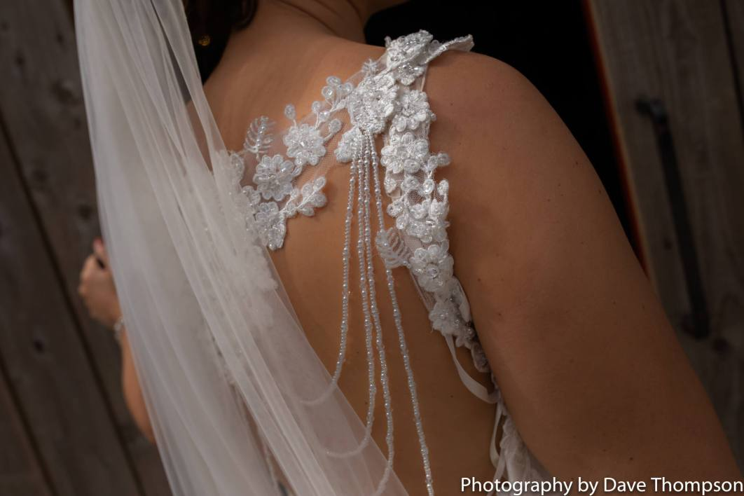 Detail shot of the back of a brides dress