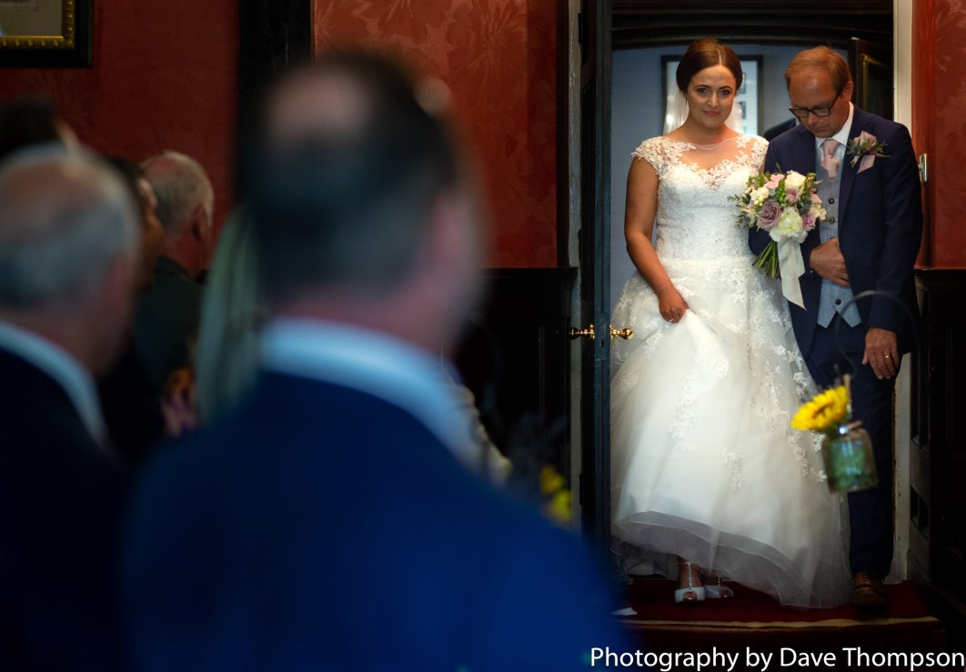 The bride and her father arrive for the ceremony