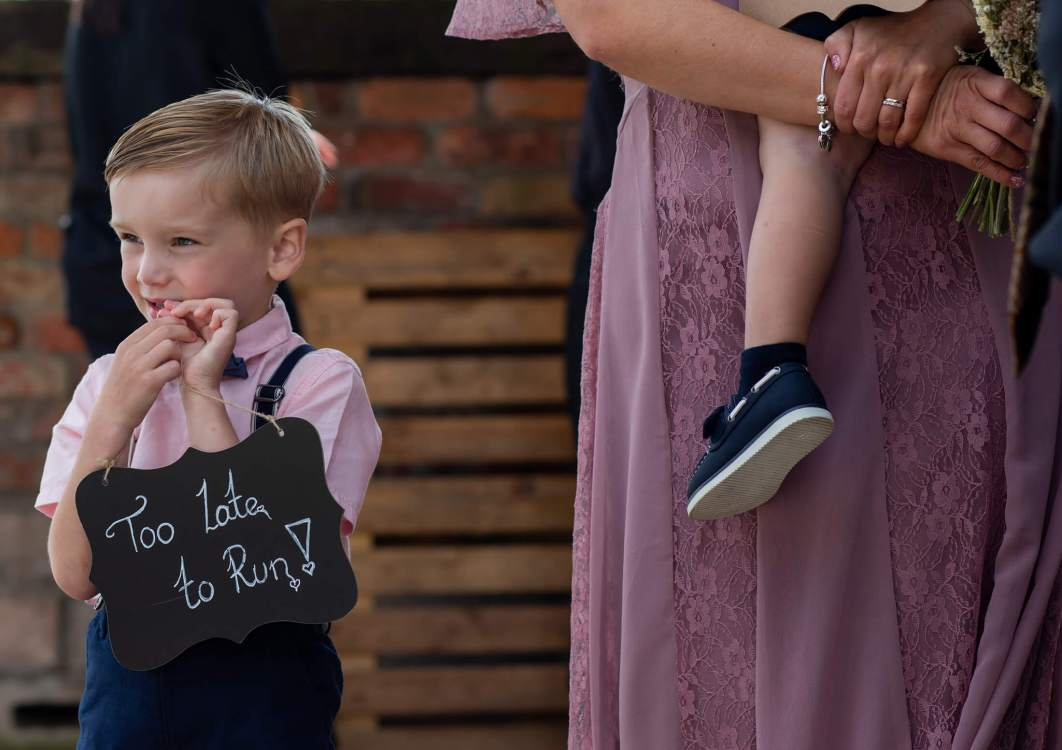 A page boy waits for the bride