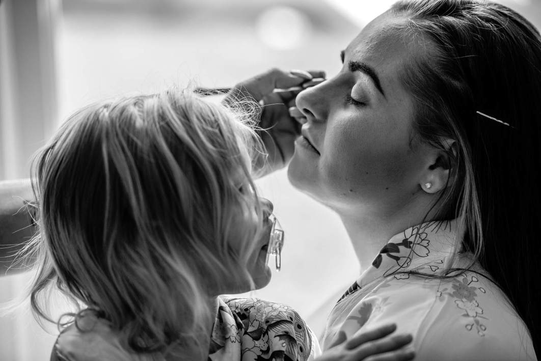 A bride and her daughter during bridal prep