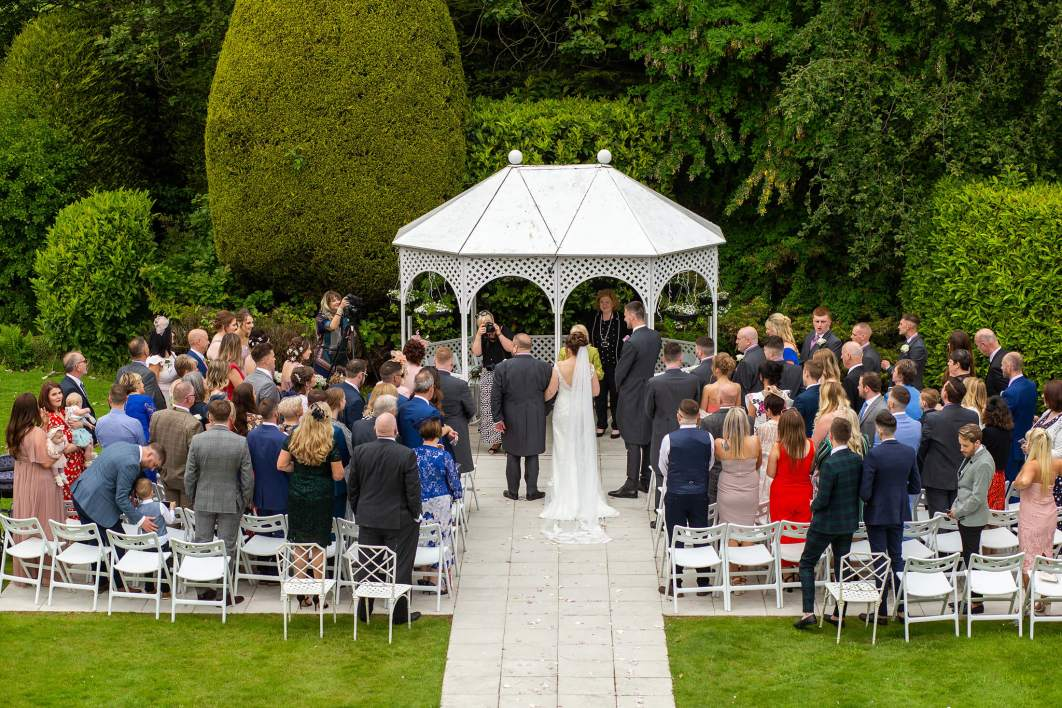 A view from a balcony of the wedding ceremony on a garden
