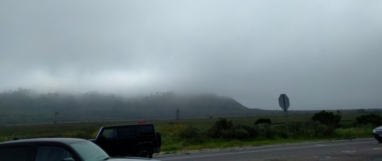 marine layer moving in and hanging on the hill