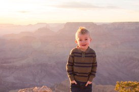 Little Steston hands in pockets on the edge of Grand Canyon