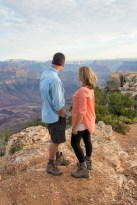 mom and dad look out over Grand Canyon