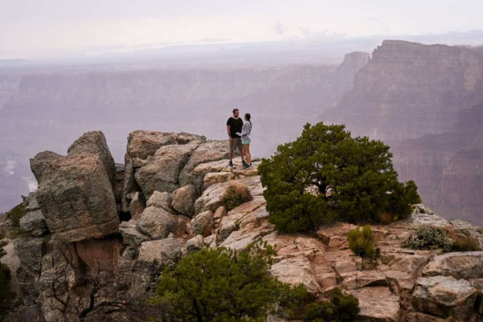 Standing on the edge at Grand Canyon proposal photo