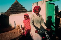 INDIA. Jodhpur. 1996. Farmer and child. Magnum Photos, NYC5921, MCS1996002 K052. Man with child on bike Jodhpur, India 1996