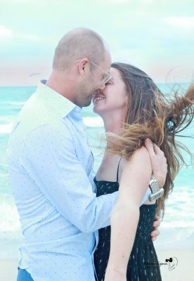 We offer engagement photography sessions in a beach or a park.