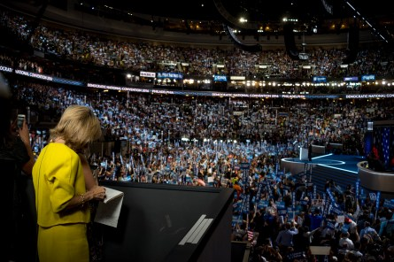 Andrea Mitchell taking notes during POTUS speech