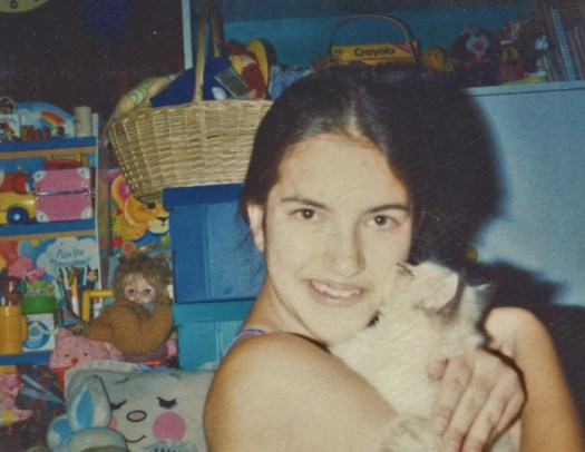 Here I am holding Maxx the cat when I was fourteen years old.
