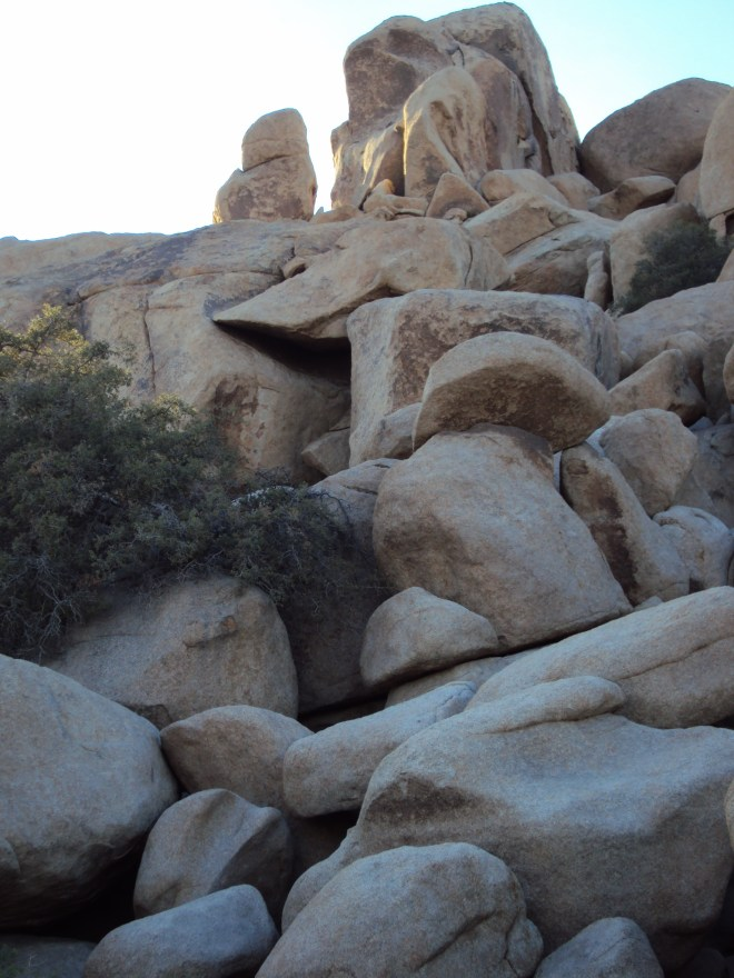 This vertical image shows the magnitude of the boulders.