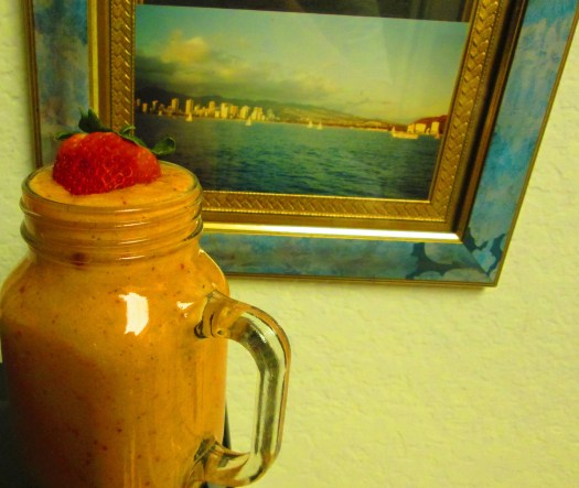 A picture I took of Waikiki Beach is behind this smoothie. I took this picture on a dinner cruise I went on many years ago, and I enjoy this simple scene very much. It puts me in the mood of visiting a tropical island as I sip on my smoothie.