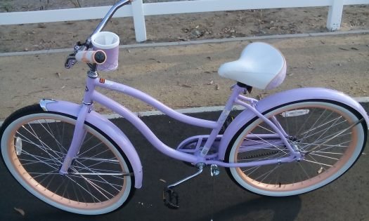 The purple beach cruiser comes with a fun beverage holder.